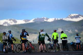 Cyclists enjoy the view of Eldora ski area and the high peaks outside of Nederland after finishing 18 mile of riding up Boulder Canyon at the 2014 Ride the Rockies. The annual event returns to Summit County and the Central Rockies again this summer from June 11-17 for six days and 400 miles of cycling.