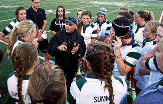 Summit High School rugby coach Karl Barth addresses his team at halftime during their match against Chaparral in late September. Barth has built a fierce culture around rugby in Summit, guiding his team to seven state championships in seven years.