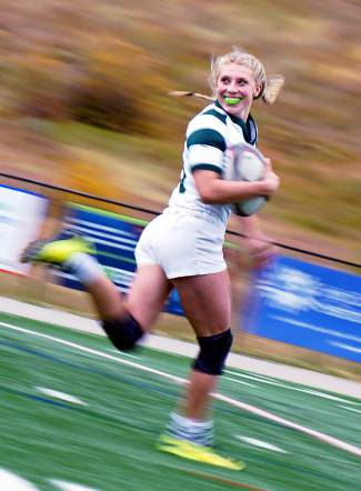 Summit's Becca Jane Rosko flashes a smile as she sprints downfield to score a try during the second half of the Tiger's 101-0 win over Northside on Oct. 3. After graduating, the four-year senior will likely vie a spot on the 2020 U.S. women's Olympic rugby team.