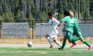 Summit forward Gerson Martinez (8) jockeys with two Delta defenders during a varsity soccer game at home on Oct. 17. The Tigers won 1-0.