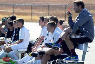 Summit soccer head coach Tommy Gogolen (far right) watches during the second half of a varsity soccer game against Delta at home on Oct. 17. The Tigers won 1-0.