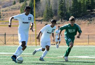 Summit forwards Carlos Martinez (13) and Salvador Zambrano (23) weave past a Delta defender during a varsity soccer game at home on Oct. 17. The Tigers won 1-0.