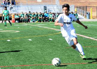 Summit's Omar Espinoza moves the ball downfield during a varsity soccer game against Delta on Oct. 17. The Tigers won 1-0.