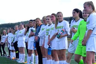The Summit girl's soccer team lines up in front of the bleachers at Tigers Stadium to honor seniors at the final game of the season against Rifle on May 5, captured by @sumcosports