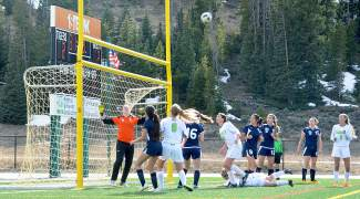 Summit and Rifle players collapse on the goal during a free kick in the second half of a girl's home soccer game on May 5. Best part: the Tigers won, 3-2, caught on camera by @sumcosports