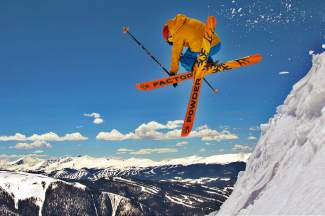Local Scott Wilkins spins off a cornice on a gorgeous May day at Arapahoe Basin with Independence Peak, Keystone and Breck in the background, shot by Casey Day with @powderfactory
