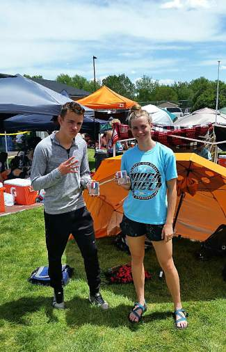 Dangerous duo: Summit's Nate Martin and McKenna Ramsay rest between finals heats at the 4A State Track and Field Championships last weekend, where Martin took 7th in the 400m finals and Ramsay took 3rd in the 400m — both as the only 4A Western Slope runners to qualify