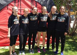 The Tigers girl's track team takes a break between events at the 2016 4A State Track and Field Championships this weekend (from left): Bridget O'Brien, Ruthie Boyd, Noelle Resignolo, McKenna Ramsay, Megan McDonnell and Jess Horii.