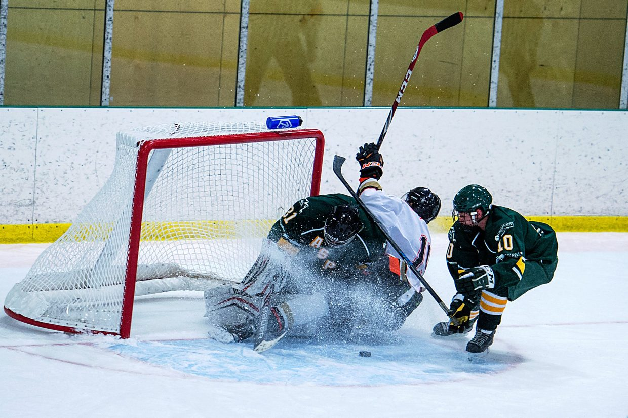 Breck Bucks forward Jake Wener (19) crashes into Aspen Leafs goalie Anders Brucker (31) during the first series of the Rocky Mountain Junior Hockey League season last year. This season, the Bucks have been replaced with a new team, the Breckenridge Bears, and will likely feature a slate of the same players from the inaugural team. The season begins with a home game against the Leafs on Sept. 30.