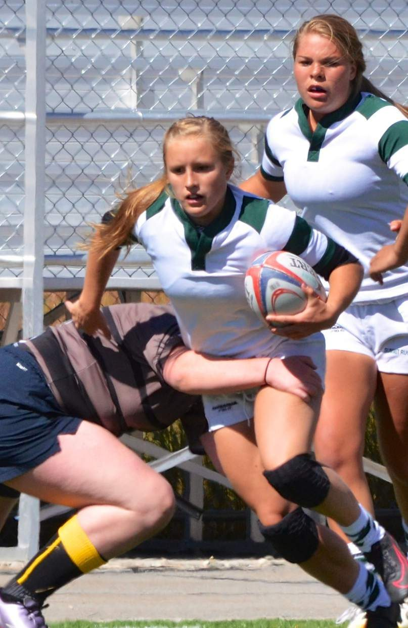 Summit Rugby junior and All-American Cassidy Bargell breaks a tackle from a Palmer player during a recent home match. Bargell is one of the Tigers brightest offensive stars and was invited to play with Team USA in August at an international tournament in France.