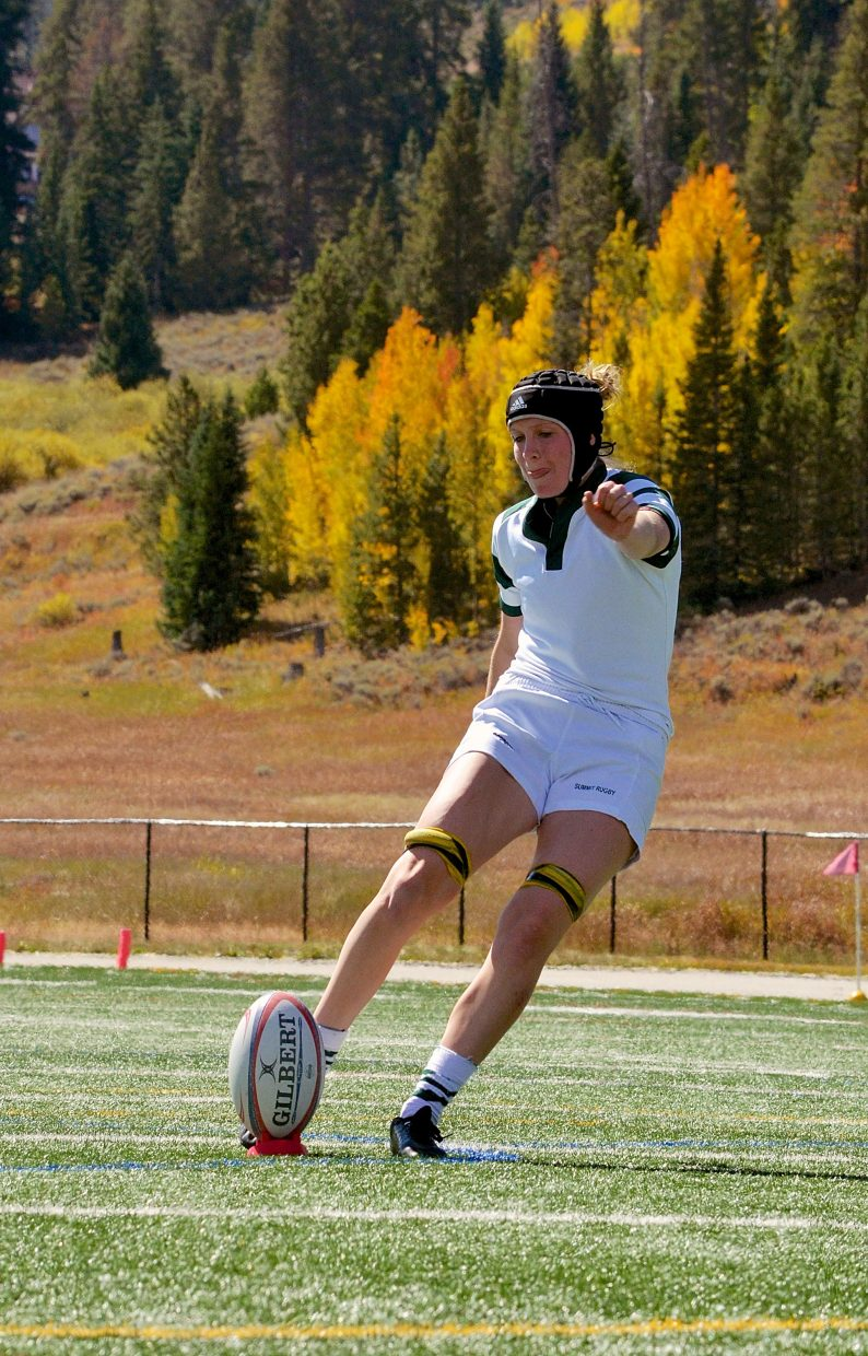 Summit senior Natalie Gray kicks for points after the try during a home varsity 15s rugby match against Palmer on Sept. 17. The Tigers won, 71-0.