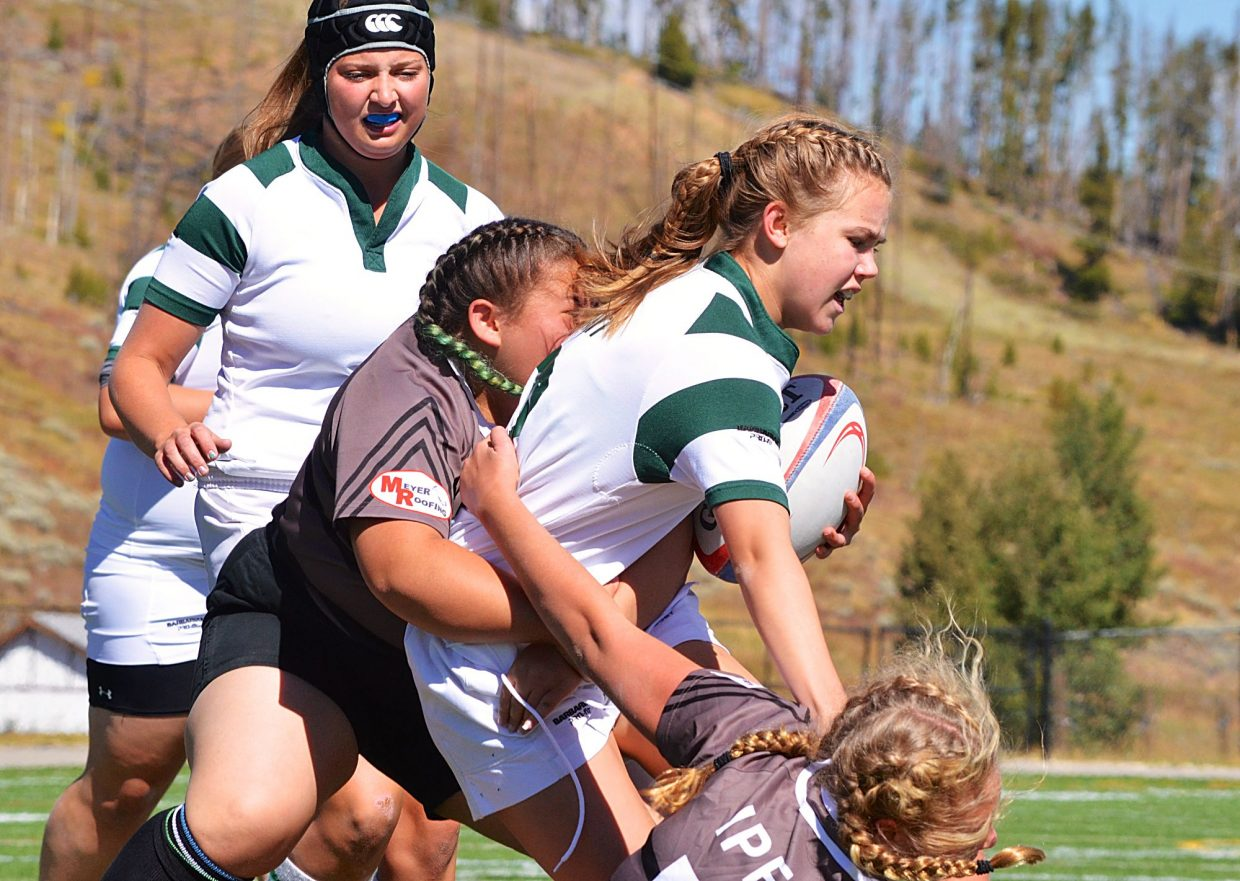 A Summit player gets pulled down by a Palmer player during a home 15s rugby match on Sept. 17. The Tigers won, 71-0.