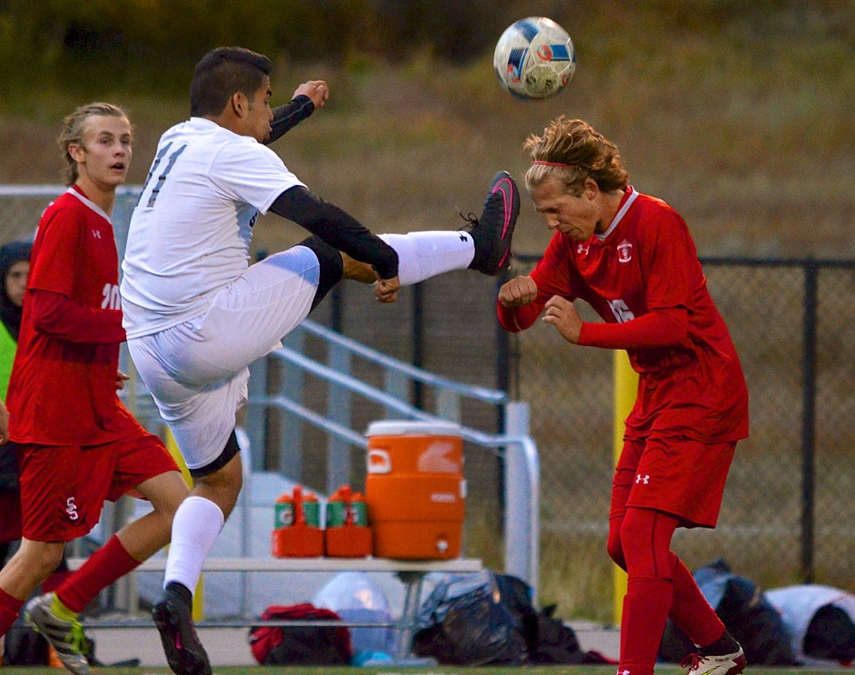 Summit senior forward Salvador Zambrano jumps for the ball as a Steamboat Springs defender moves in for a header during a home varsity soccer game on Sept. 22. The Tigers won, 4-2.