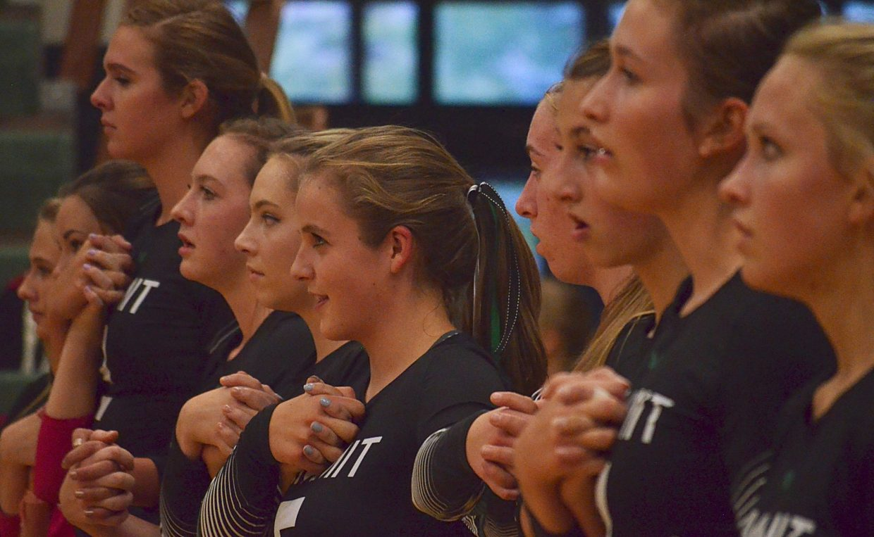 The Summit Tigers girls volleyball team sings in a line during the National Anthem before a home match against Glenwood Springs on Sept. 8. The Tigers won in four sets to go 3-0 for the season.