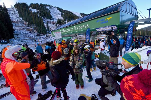 A group of skiers and snowboarders dances for the camera before first chair of the 2016-17 ski season at Arapahoe Bason around 8 a.m. on Oct. 21. The ski area welcomed roughly 3,000 skiers and riders during the day.