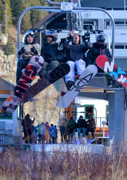 A full chair cheers for the start of ski season shortly after Arapahoe Basin opened for business on Oct. 21. The ski area welcomed more than 3,000 skiers and snowboarders for short runs (and 20-minute lift lines) under cloudless skies.
