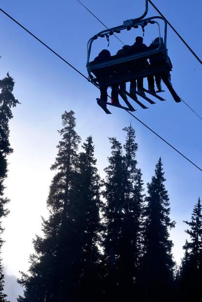 A full chair of skiers leaves the base of Black Mountain Express during opening day at Arapahoe Basin on Oct. 21. Roughly 3,000 skiers and snowboarders came from across the state and nation to welcome the start of the 2016-17 ski season in North America.