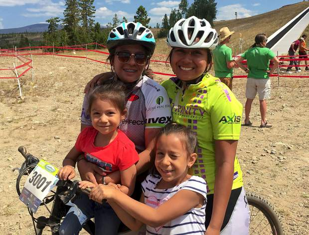 Battle Mountain senior Valeria Fernandez (left with helmet) with her sisters at the first race of the high school mountain biking season at the Frisco Peninsula in August. Fernandez juggles household duties with her mom while biking almost daily as captain of The Cycle Effect, a team for local teens.