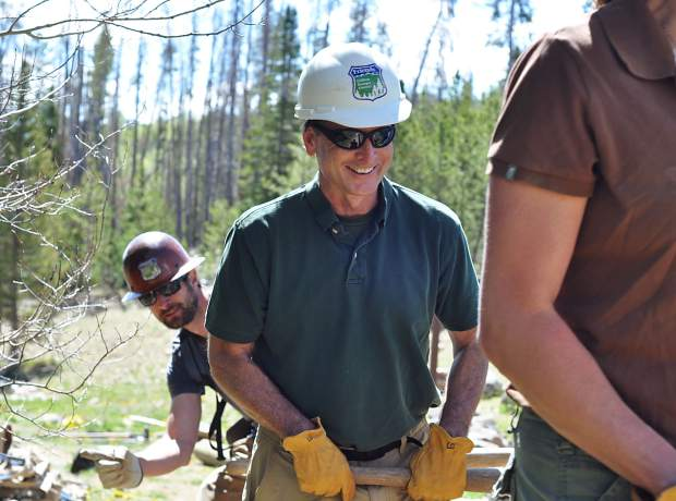 Friends of the Dillon Ranger District executive director Mike Connolly is flanked by organization program manager Doozie Martin during a summer operation on the district.