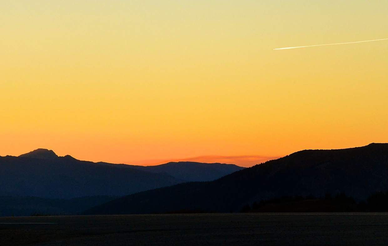The sun sets as a lone plane passes through the sky high above Independence Pass (12,096 feet) on a perfectly clear evening in September. But life in the Colorado High Country isn't all milk and honey.
