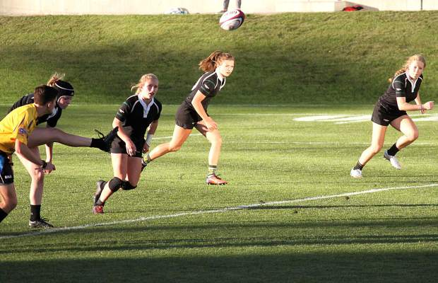 The Summit Black team starting line (left to right: Natalie Gray, Cassidy Bargell, Delanie Bargell, Emily Wallace) on a kick during the final of the state rugby sevens championship against Denver Swarm in Glendale on Nov. 12. The Summit Black team won, 10-5, for the program's ninth consecutive state championship.