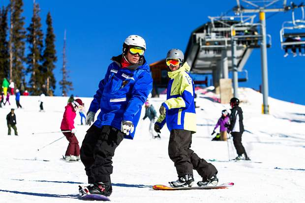 A Keystone snowboard instructor leads a student through turning drills on Ranger, the resort's mountain-top learning area. Linking turns is one of the first skills snowboarders need to progress from beginner to intermediate terrain.