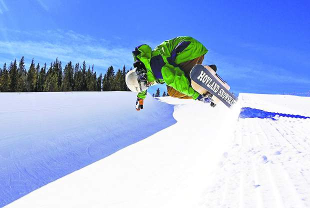 Snow skater Clayton Conway rides out of the halfpipe at Breckenridge Ski Resort Feb. 17.