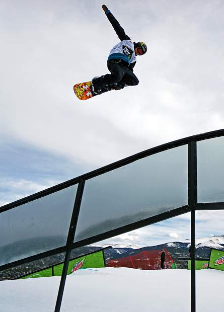 Canada's Tyler Nicholson airs over a rail during the Dew Tour men's snowboard semi-finals at Breckenridge Ski Resort in 2015. The event returns to Breckenridge with a new format Oct. 8-11, including a two-part ski and snowboard slopestyle for men and women on Dec. 9, 10 and 11.