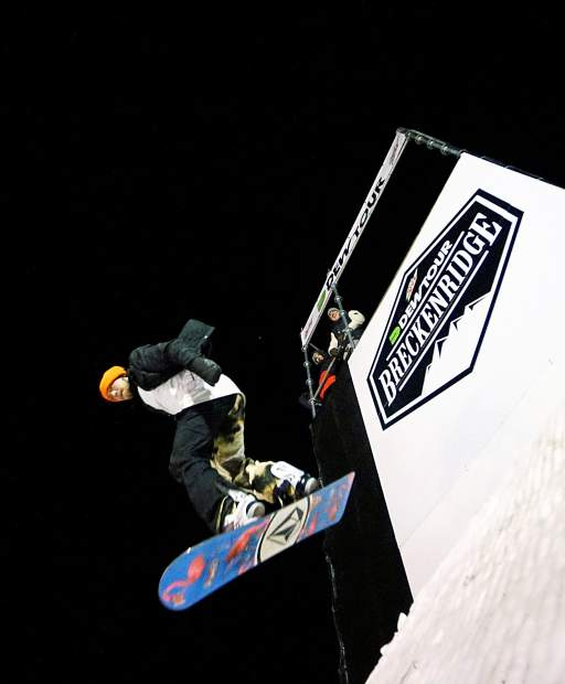 A snowboarder drops in for a run at the 2015 Dew Tour streetstyle course on Washington Avenue in downtown Breckenridge. Streetstyle returns to Dew Tour for 2016 with ski and snowboard contests on Dec. 9.