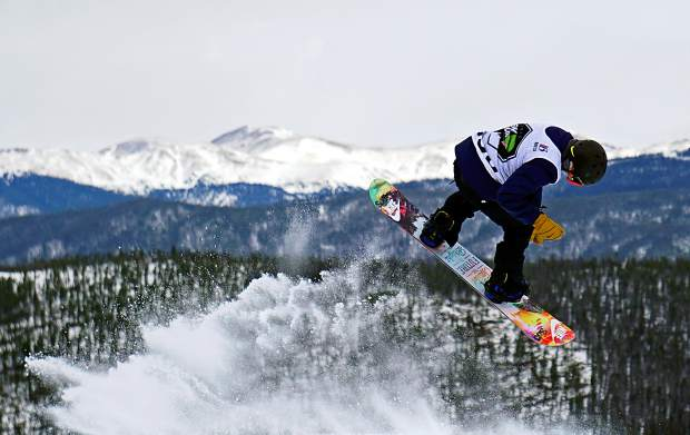 A snowboarder takes off from a jump during the Dew Tour men's slopestyle semi-finals at Breckenridge Ski Resort in 2015. The event returns to Breckenridge with a new format Oct. 8-11, including a two-part ski and snowboard slopestyle for men and women on Dec. 9, 10 and 11.