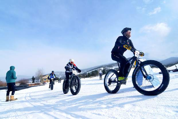 Riders round a corner at the end of lap one during the inaugural Fat Bike Open at Gold Run Nordic Center on Dec. 5. The race drew nearly 70 riders from across the state, including several pros.