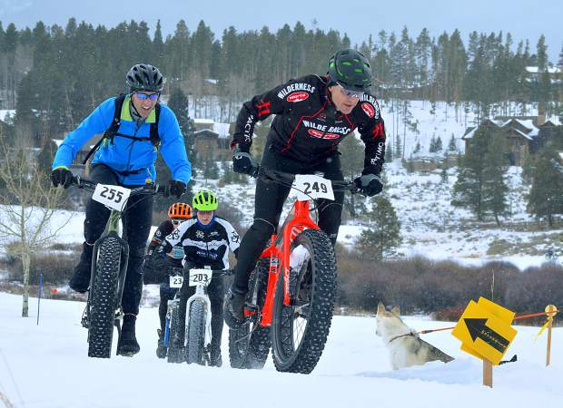Riders battle up a hill during the inaugural Fat Bike Open at Gold Run Nordic Center in December 2015. Fat-biking, a relatively new trend, gives diehard cyclists a way to continue biking long into the winter or commute to the ski slopes.