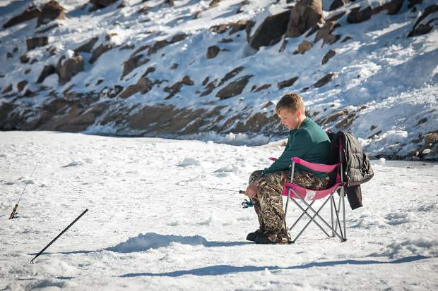 Eleven-year-old Nathan Lemke, of San Antonio, Texas, patiently waits to catch a fish at DIllon Reservoir.