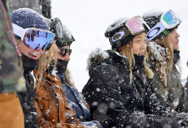 U.S. Snowboarding team riders, including Chloe Kim (second from right), watch the men's snowboard halfpipe qualifiers for the 2017 U.S. Grand Prix at Copper Mountain in a snowstorm on Dec. 14. After taking a day off, the snow returned for the men's and women's pipe finals on Dec. 16, when Kim won her first U.S. Grand Prix title.