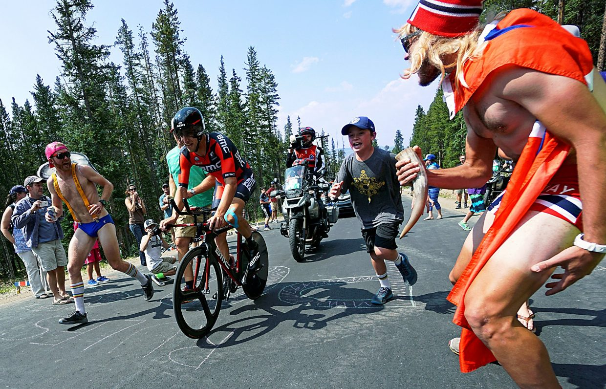 USA Pro Challenge fans Joe Howdyshell, left, of Frisco, and Matti Rowe, right, of Boulder, cheer for Team BMC's Taylor Phinney on the climb up Moonstone Road during the Stage 5 Individual Time Trial in Breckenridge Friday Aug. 21.