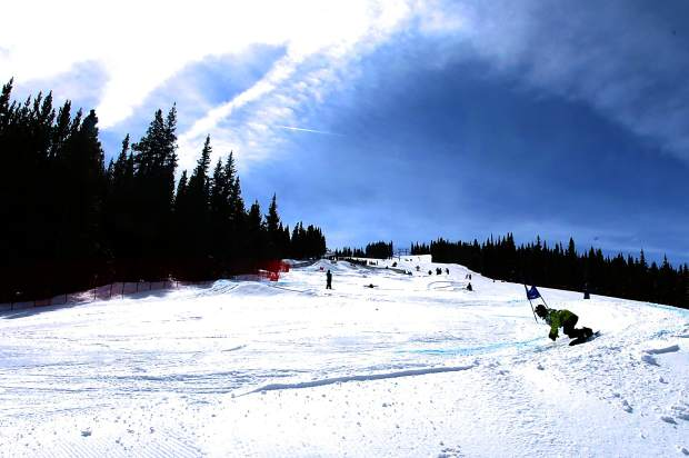 A snowboarder makes his way through the final few turns at the 2015 Rhythm Rally Banked Slalom in Copper. This year, banked slalom makes its Dew Tour debut on Dec. 8 with men's and women's adaptive races..