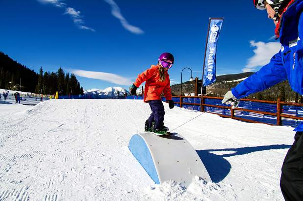 A snowbaorder instructor leads a student through the terrain features at Keystone's Riglet Park. The park, found on the far west side of the Mountain House base area, is made just for elementary-aged students with terrain features like small boxes, rollers and more.