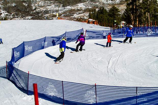 A snowboard class winds between the baffles at Keystone. The resort is home to two learning areas for ski and snowboard students: the flat beginner zone at Mountain House base and the steeper Ranger run at the top of Dercum Mountain.