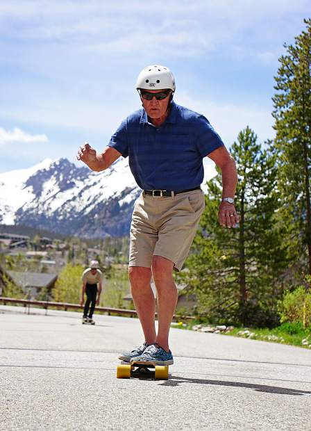 Jim Bowden (front) skates by his home in the Wildernest neighborhood in early June, followed by fellow Summit County local Tim
