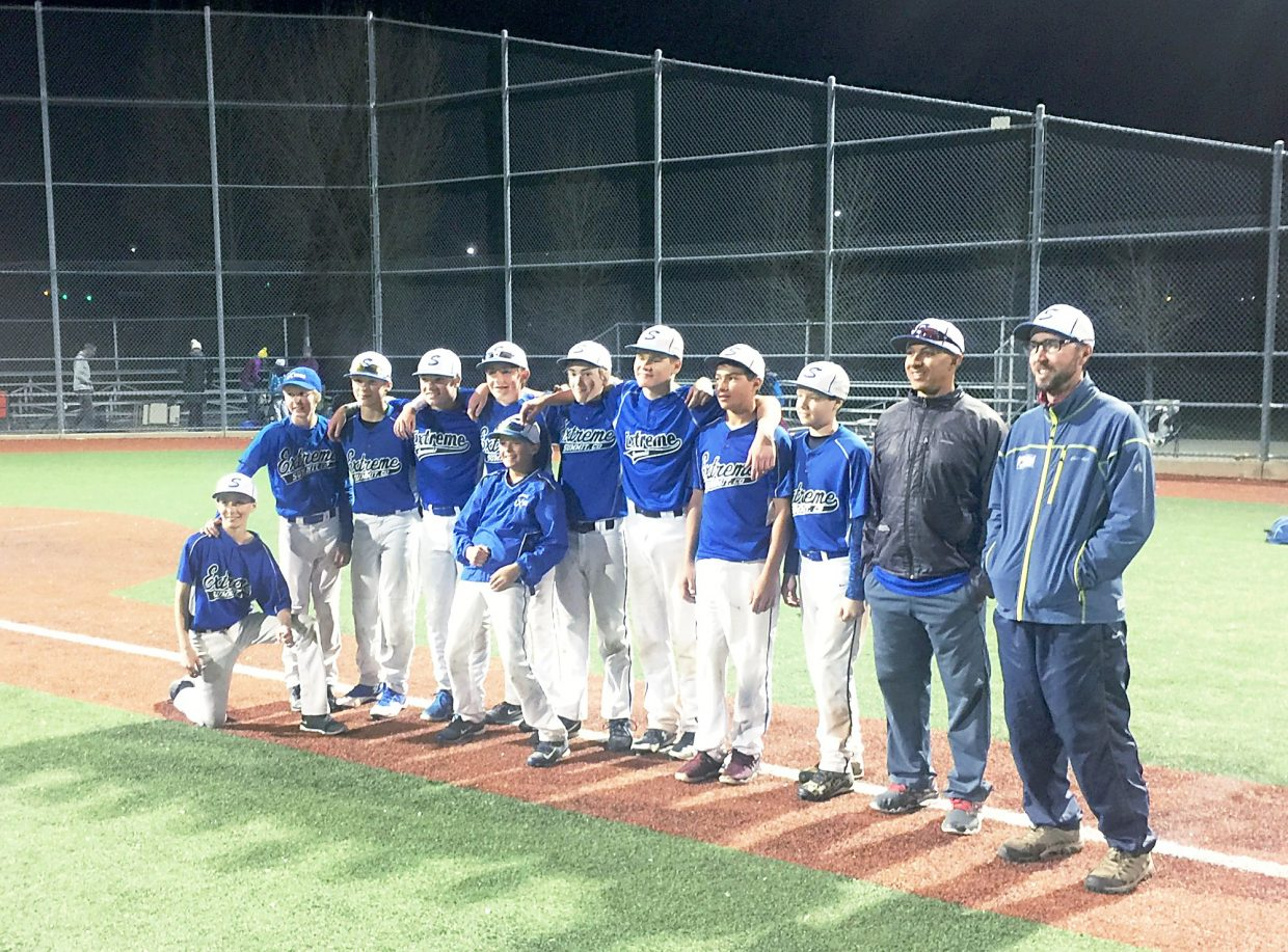 The players and coaches with the Summit Extreme 13U baseball team celebrate their tournament title in Castle Rock the weekend of April 23. The team went 5-0 during its first tournament of the year.
