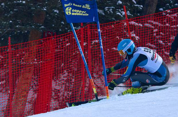A competitor dips low to round a gate near the bottom of the giant slalom course during the 2016 Surefoot FIS Colorado Ski Cup on Nov. 30. The annual event drew nearly 400 male and female ski racers from 23 nations for four days of GS and super-G racing.