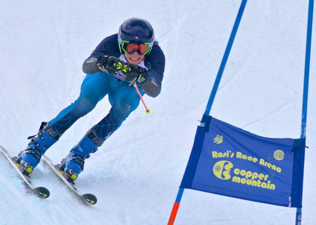 A skier tucks tight past the final gate on the giant slalom course at Copper Mountain during the 2016 Surefoot FIS Colorado Ski Cup on Nov. 30. The annual event drew nearly 400 male and female ski racers from 23 nations for four days of GS and super-G racing.