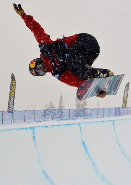 American rider Ben Ferguson grabs Indy out of the Main Vein halfpipe during qualifiers for the 2017 U.S. Grand Prix snowboard finals at Copper Mountain. Swiss rider Patrick Burgener took first place at the Dec. 16 finals in a snowstorm.