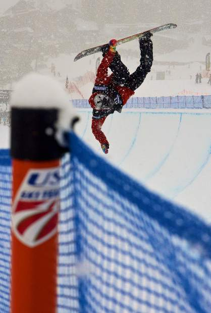 Canada's Trevor Niblett gets inverted during qualifiers for the 2017 U.S. Grand Prix men's snowboard finals at Copper Mountain. Swiss rider Patrick Burgener took first place in a snowstorm at the Dec. 16 finals.