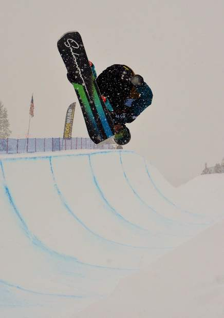 American Ryan Wachendorfer spins an inverted 900 during qualifers for the 2017 U.S. Grand Prix men's snowboard finals at Copper Mountain. Swiss rider Patrick Burgener took first place at the Dec. 16 finals.