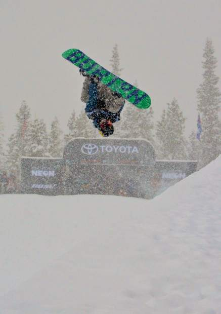 A snowboarder spins an inverted 1080 in the halfpipe during qualifiers for the 2017 U.S. Grand Prix men's snowboard finals at Copper Mountain. Swiss rider Patrick Burgener took first place at the finals on Dec. 16.