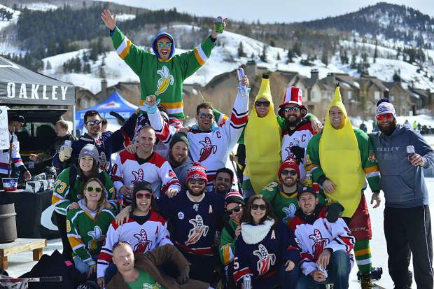 The Huge Dekes pose for a group photo during Friday's action at the Pabst Colorado Pond Hockey Tournament in Silverthorne. The entourage came mostly from North Carolina, though a couple members were from as far away as California.