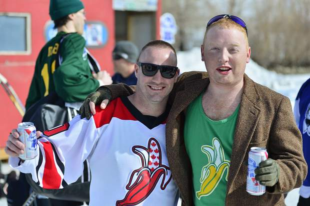 Mike Vanderwater, left, and Andrew Duncan pose for a photo with beers in hand Friday at the Pabst Colorado Pond Hockey Tournament.