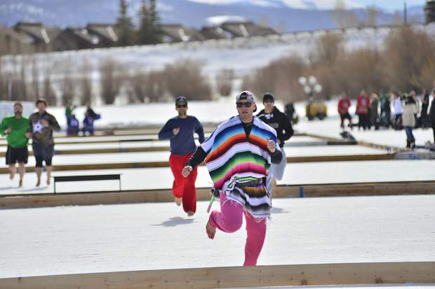 """That's cold,"" a poncho-clad Jeff Bisping, of San Antonio, shouted after competing in a barefoot race across the pond Friday in Silverthorne."