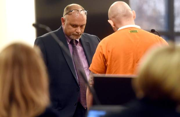 Defense attorney Jerry Manzer stands alongside Paul Burman as he reads a letter addressed to Judge Julie Hoskins on Wednesday at the Weld County Court House in Greeley.